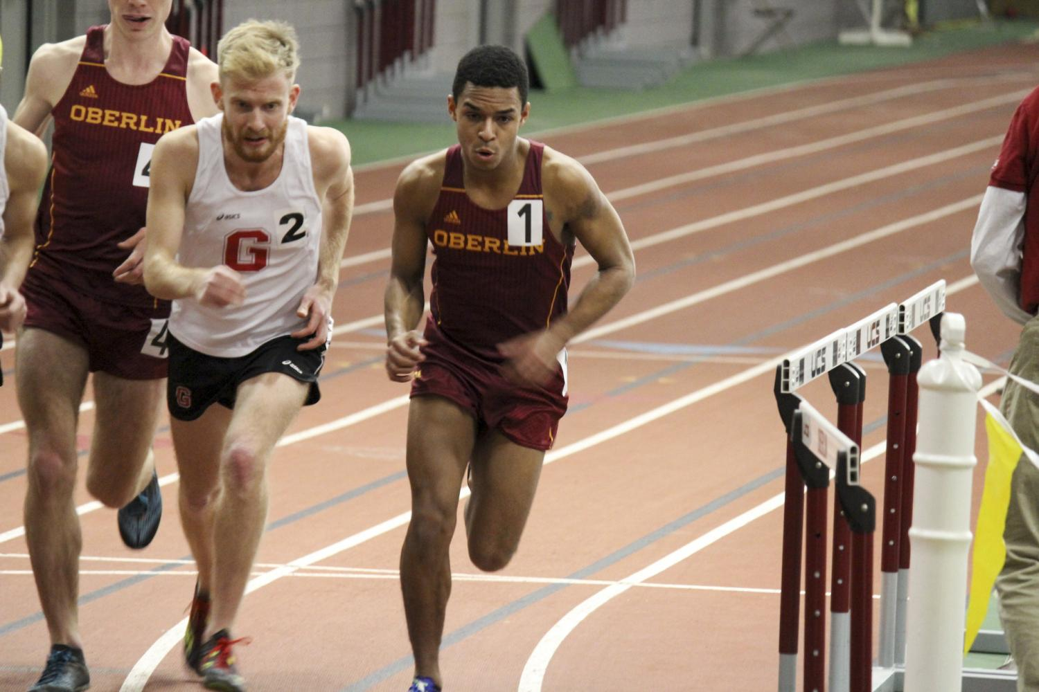 Senior captain E.J. Douglass edges past a Grove City runner in the Dan Kinsey Invitational in February. This weekend, track and field will head to Hillsdale College in Hillsdale, MI, and Ashland University in Ashland, Ohio.