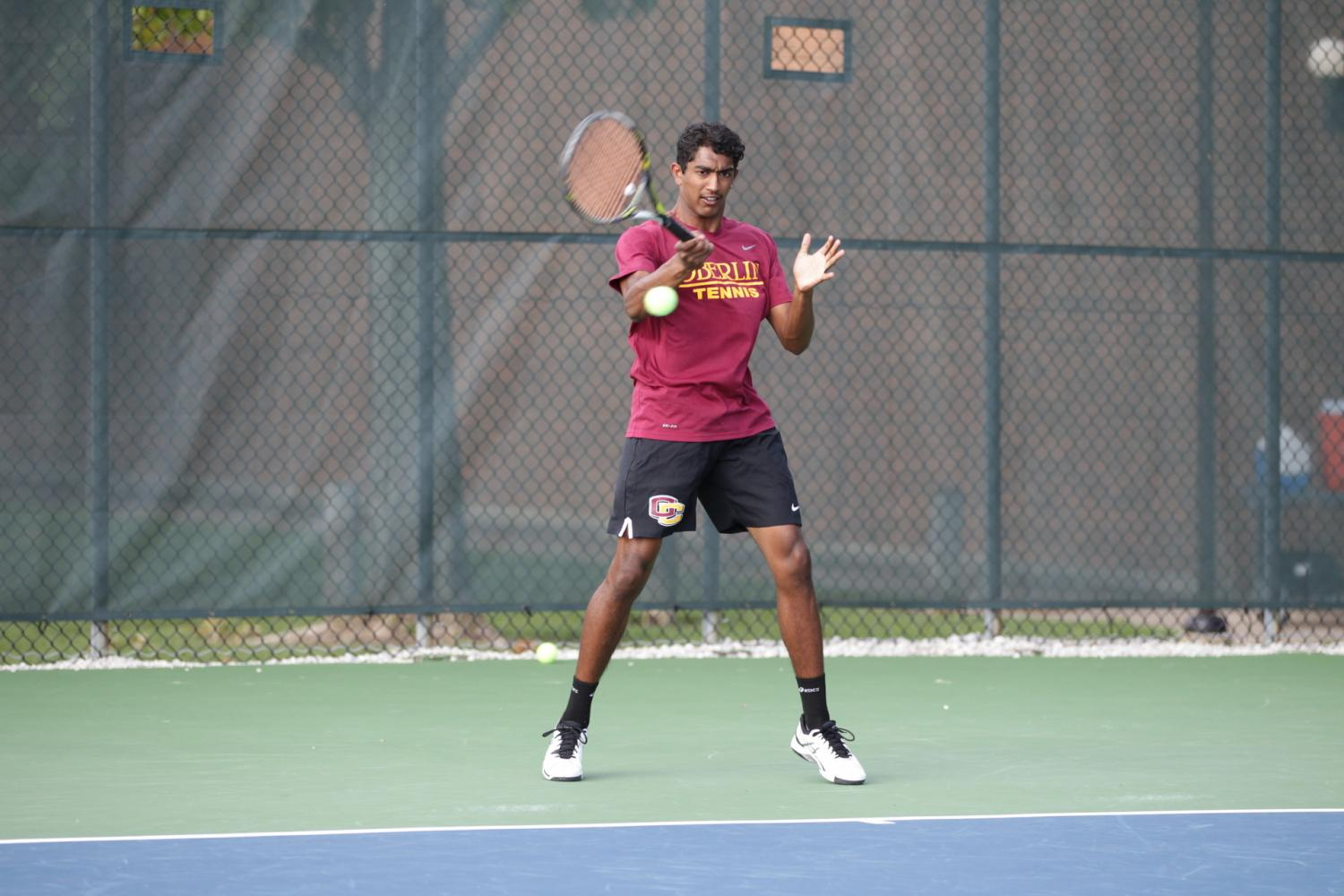 Junior Manickam Manickam completes a forehand follow-through. The Yeomen completed their season with a 5–2 victory over Denison University in the third-place match of the NCAC Tournament.