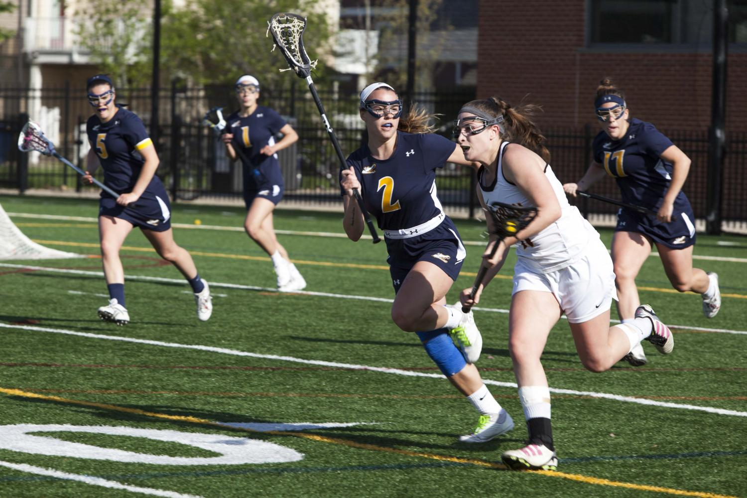 Sophomore midfielder Jenna Butler races past an Allegheny College defender in the NCAC Semifinals last Wednesday. The Yeowomen defeated the Gators 13–8 to secure a spot in the NCAC Championship for the second time in the past three years.
