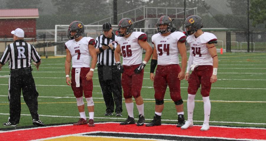 Senior+captains+Anthony+Allen%2C+number+66%2C+and+Avery+McThompson%2C+number+54%2C+represent+the+Yeomen+for+the+coin+toss+in+their+24%E2%80%936+season+opening-victory+against+Kalamazoo+College+Sept.+2.+The+Yeomen+will+play+the+Denison+University+Big+Red+tomorrow+in+Granville%2C+Ohio.