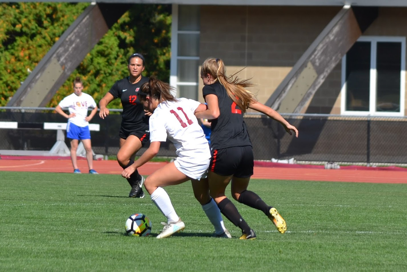 First-year midfielder Sydnie Savarese fights for the ball in the Yeowomen's face-off against the Ohio Wesleyan University Battling Bishops Sept. 23. The Yeowomen will take the field tomorrow night against the Hiram College Terriers in Hiram, Ohio.