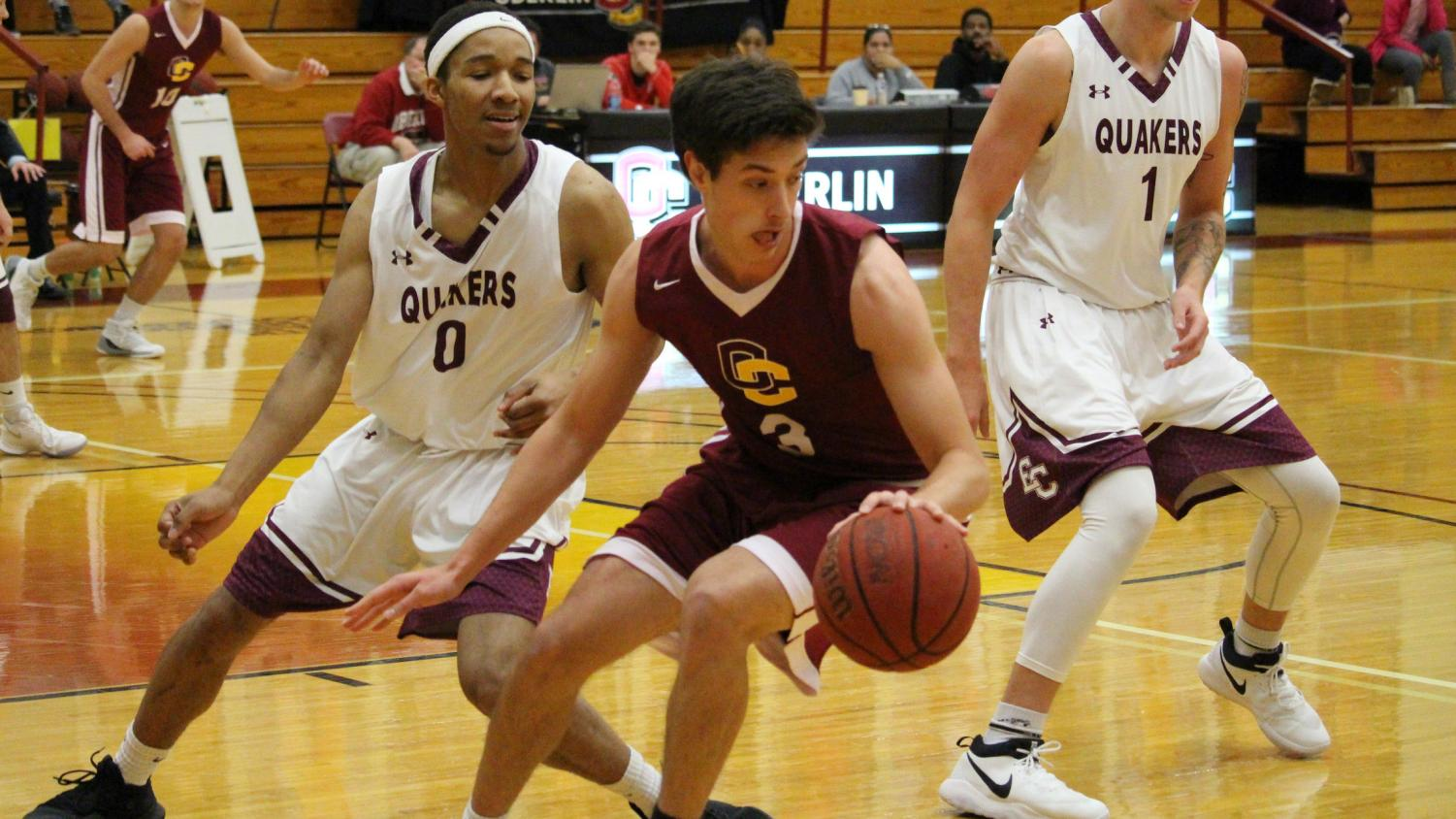 Junior guard Eli Silverman-Lloyd spins by the Earlham College Quakers on his way to 12 points in the Yeomen's 81–80 home win Nov. 19. The Yeomen, who are 4–2 this season, play their next game against the Hiram College Terriers in Philips gym at 3 p.m. tomorrow.
