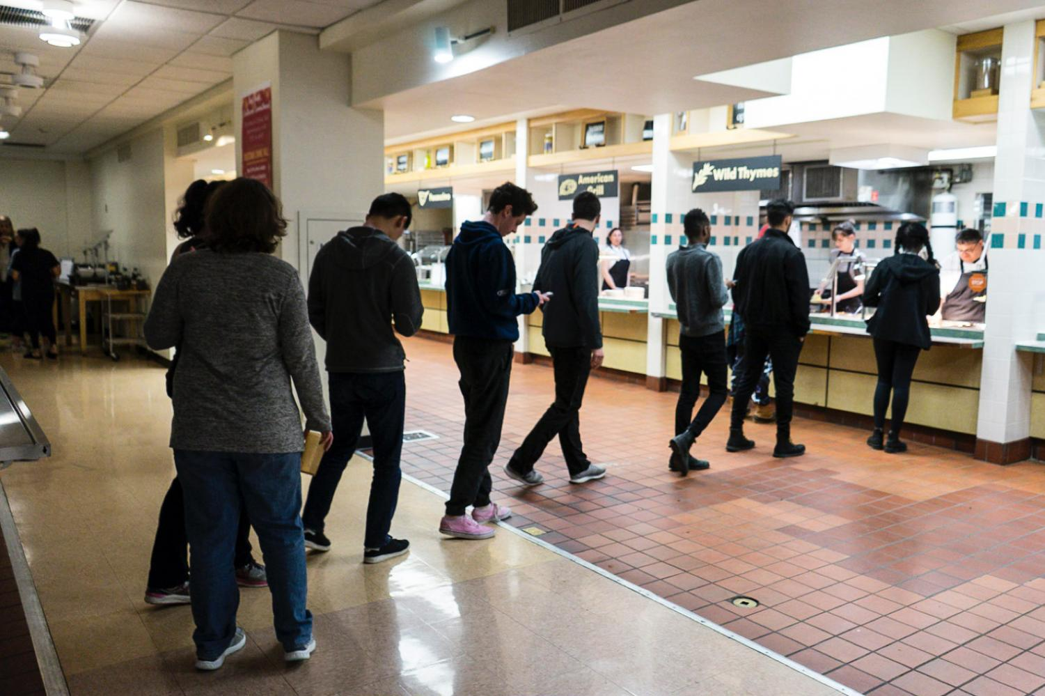 Students line up to get food at Fourth Meal, which will be moved to DeCafé and the Rathskeller next fall due to the closing of Dascomb Dining Hall.