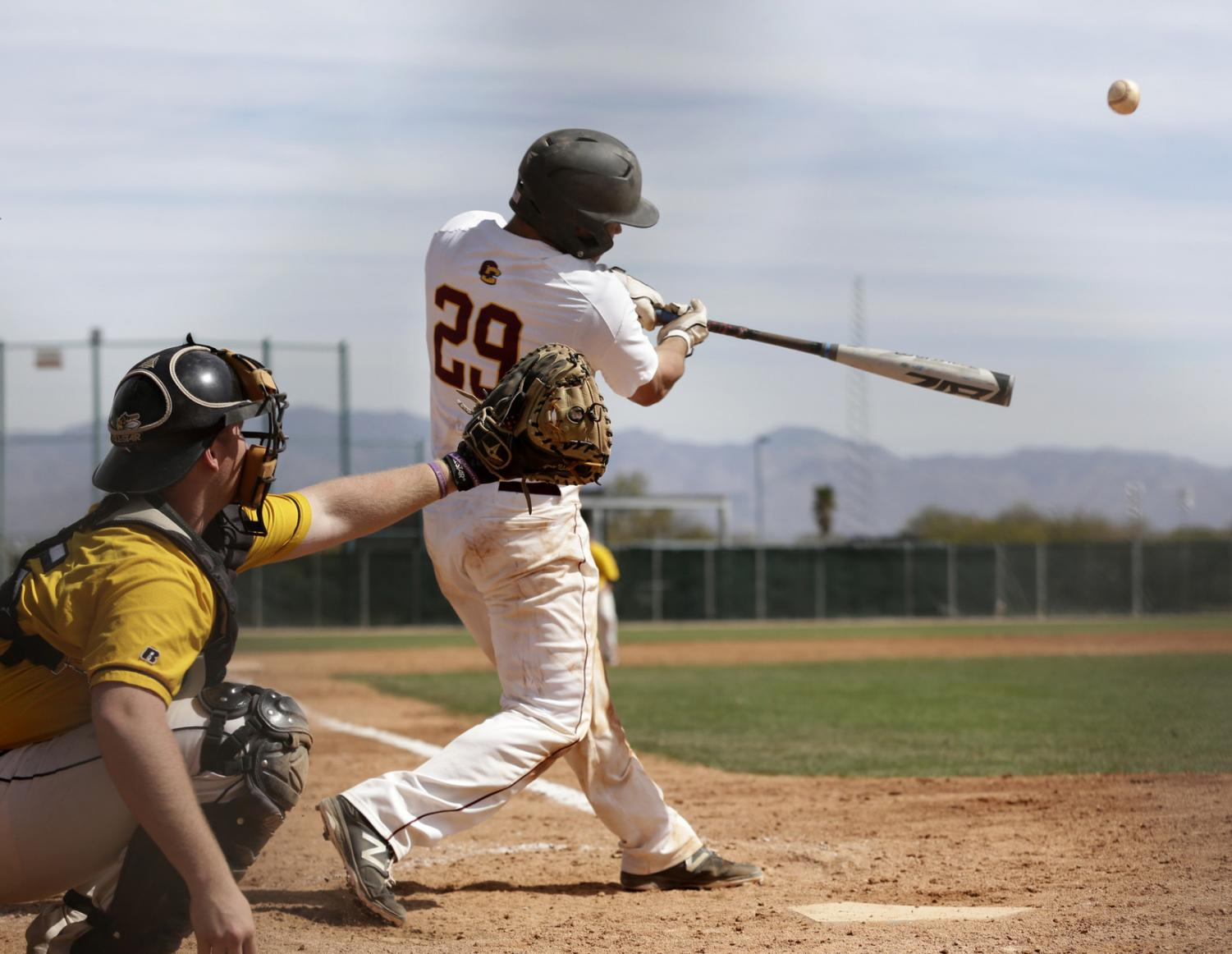Junior catcher Brendan Mapes rips the ball against competition in Tucson, AZ. Mapes currently leads the team in conference play with a .350 batting average.