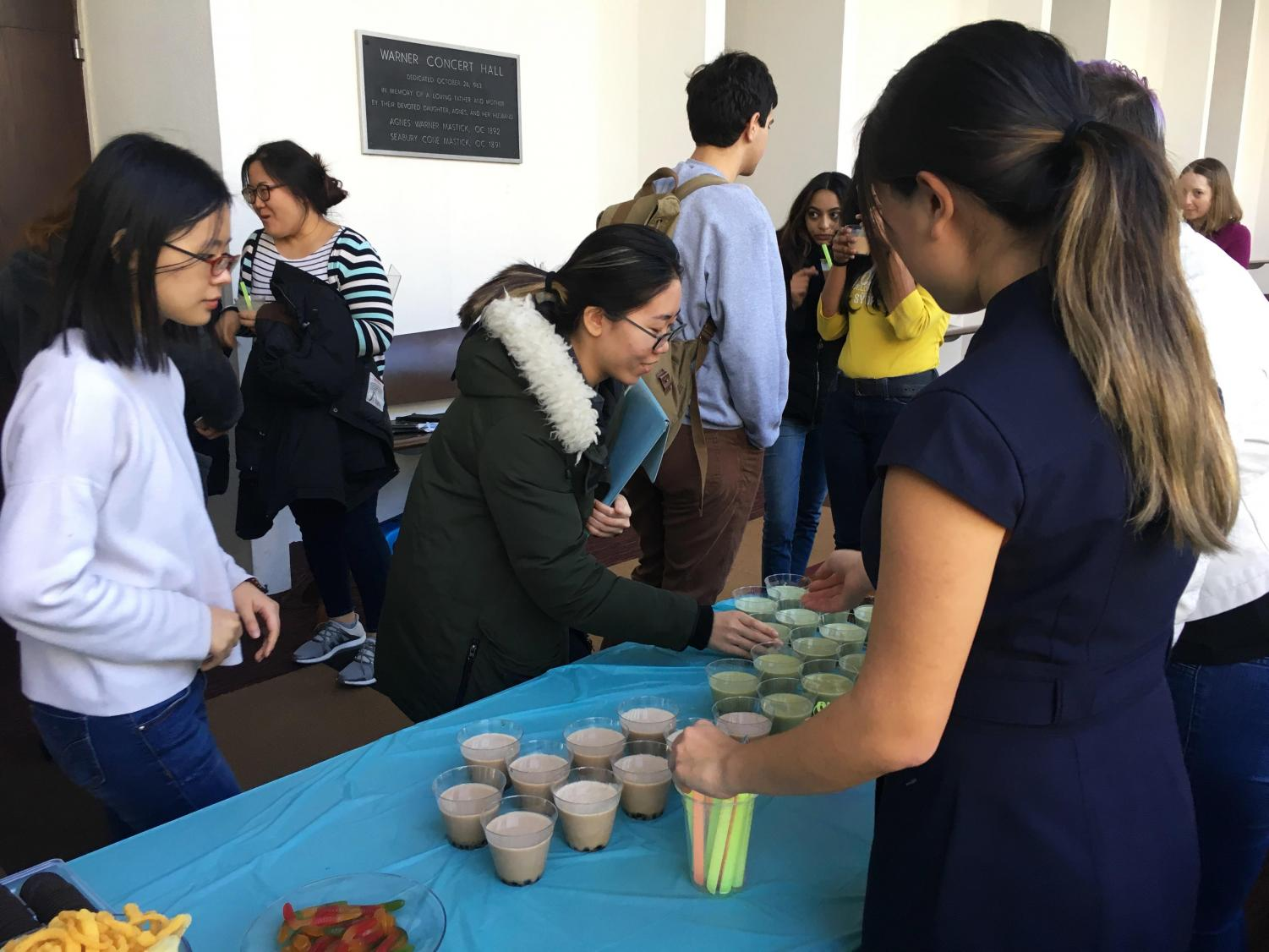 College sophomore Katie Kim passes out boba outside of Warner Concert Hall. Kim runs a small business Bobalin which she started last year after getting an honorable mention and $2,000 in the LaunchU competition.