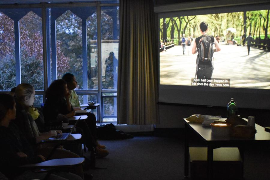 Students+watch+a+screening+of+the+documentary%2C+We+Exist%3A+Beyond+the+Binary%2C+as+part+of+Trans+Week+of+Action.+