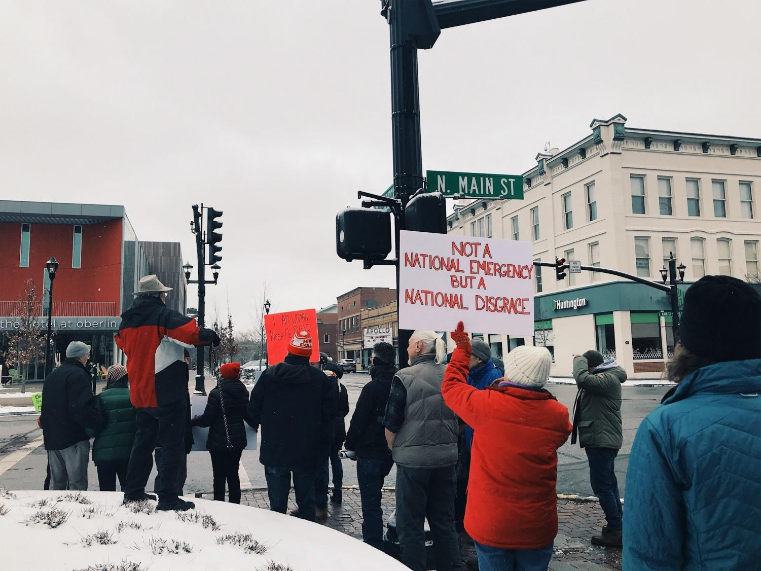 Protesters organized in downtown Oberlin on Monday to protest President Trump's declaration of a national emergency.