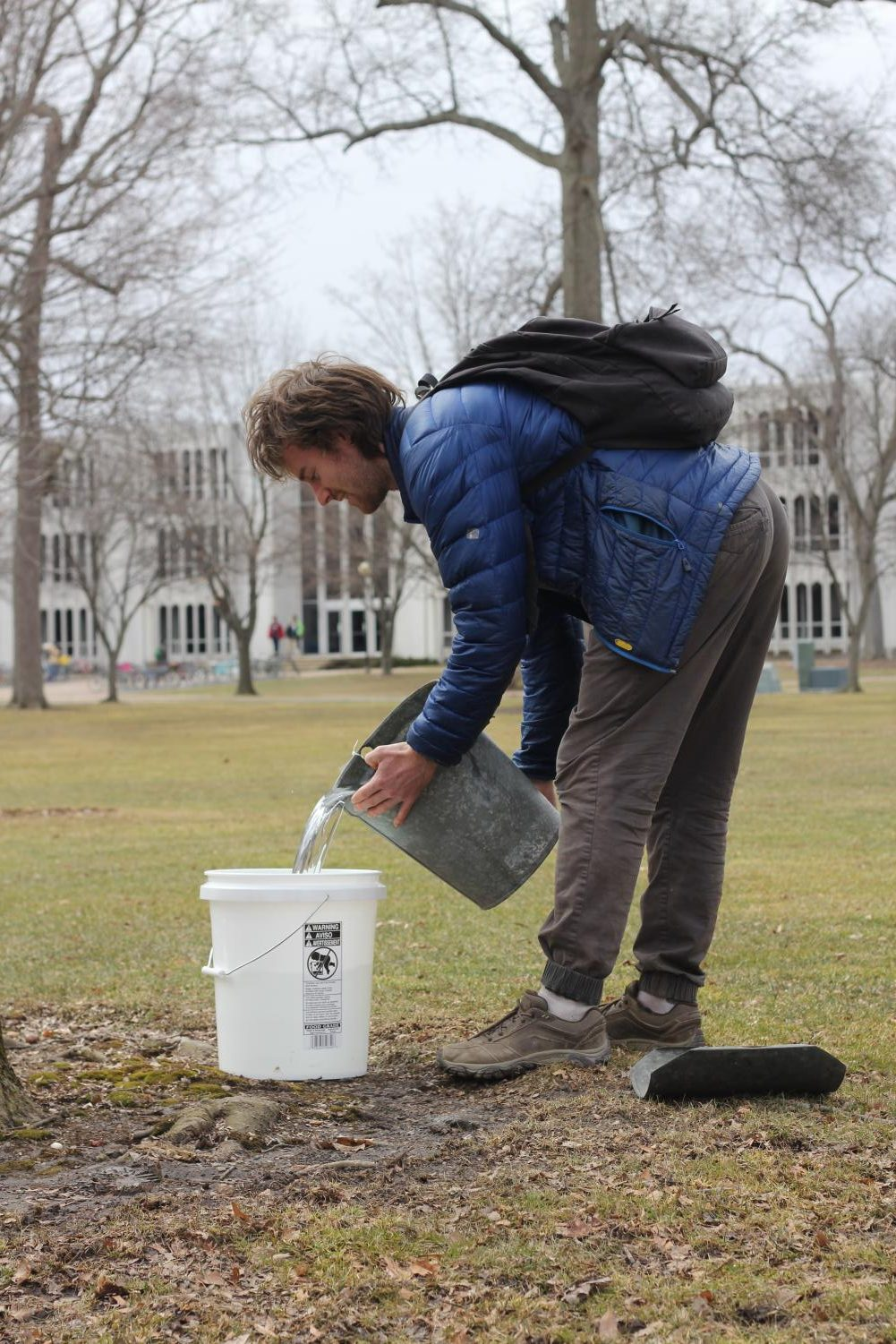 Will Wickham prepares materials for tapping trees in Tappan Square. The sap they collect will be boiled into maple syrup.