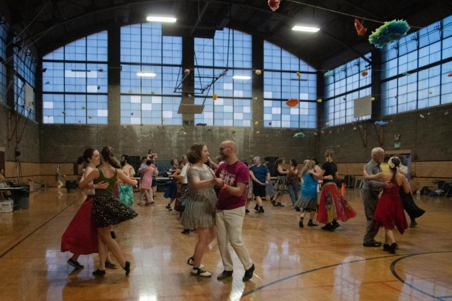 Oberlin%E2%80%99s+annual+Dandelion+Romp+celebrated+its+20th+anniversary+last+weekend%2C+filling+Hales+Gym+with+an+animated+crowd+of+dancers.+Dandelion+Romp+is+a+three-day+contra+dance+event+where+community+members+come+together+and+practice+the+folk+dance.+Contra+is+an+American+dance+form+with+Scottish%2C+French%2C+and+English+origins+and+features+lines+of+couples+who+intermingle+throughout+a+dance%2C+led+by+a+caller+who+teaches+the+dance%E2%80%99s+steps+and+rules.%C2%A0Oberlin+hosted+the+event+from+7%3A30+p.m.+to+12+a.m.+Friday%2C+9+a.m.+to+12+a.m.+Saturday%2C+and+from+9+a.m.+to+4%3A00+p.m.+Sunday%2C+with+supplemental+workshops+at+the+Cat+in+the+Cream+on+Saturday+and+Sunday.+The+proceedings+featured+Dela+Murphy+and+Alexandra+Deis-Lauby%2C+two+touring+callers%2C+and+touring+bands+Center+Street+and+Sassafras+Stomp.+The+event%2C+which+was+organized+by+College+seniors+Mikaela+Fishman+and+Caide+Jackson%2C+mid-year+graduate+Adam+Work%2C+College+first-year+Eliza+Goodell%2C+and+double-degree+senior+Molly+Tucker%2C+drew+a+range+of+dancers+%E2%80%94+some+Oberlin+students+but+also+many+alumni%2C+Oberlin+residents%2C+and+contra+dancers+from+various+walks+of+life.+Swing+by+next+year+or+come+to+the+on-campus+contra+dances+each+month+if+you%E2%80%99d+like+to+join+in+the+fun%21%C2%A0