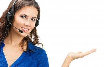 21694676 - portrait of happy smiling cheerful beautiful young support phone operator showing; isolated over white background