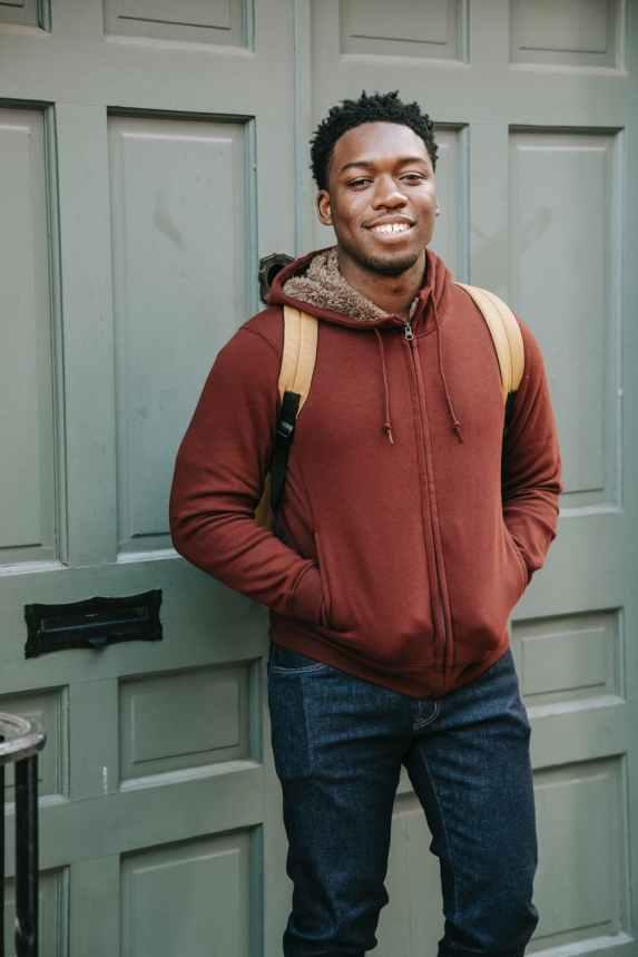 cheerful black man near door