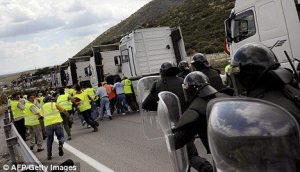 Clashes: Spanish police arrive to break up a picket line by striking Spanish truckers in Iznalloz, near Granada