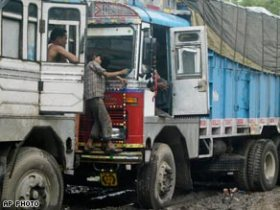 A worker cleans a truck in Allahabad, India. Millions of truck drivers went on strike across the country Wednesday.