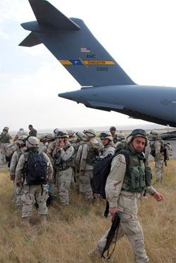 U.S. military planes transported Georgian troops from Iraq to deploy against Russians in conflict over South Ossetia.