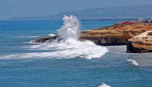 High surf along Sunset Cliffs on July 24, 2009, captured by Jim Grant.