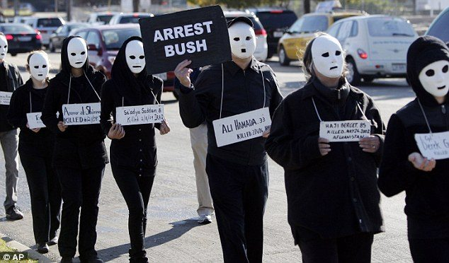 Masked Protesters Call For George Bush S Arrest For War Crimes As He