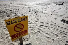 sewer spill sign beach