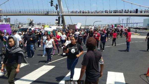 Unión del Barrio and Barrio Logan protesters on Harbor Drive heading to Trump protest, May 27, 2016