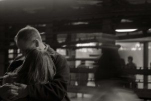 Couple hugging in the subway station, Grand Central