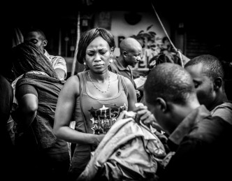 Monochrome: Young woman in the market, checking out clothes