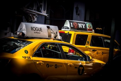 Color photography: two yellow cabs - NYC