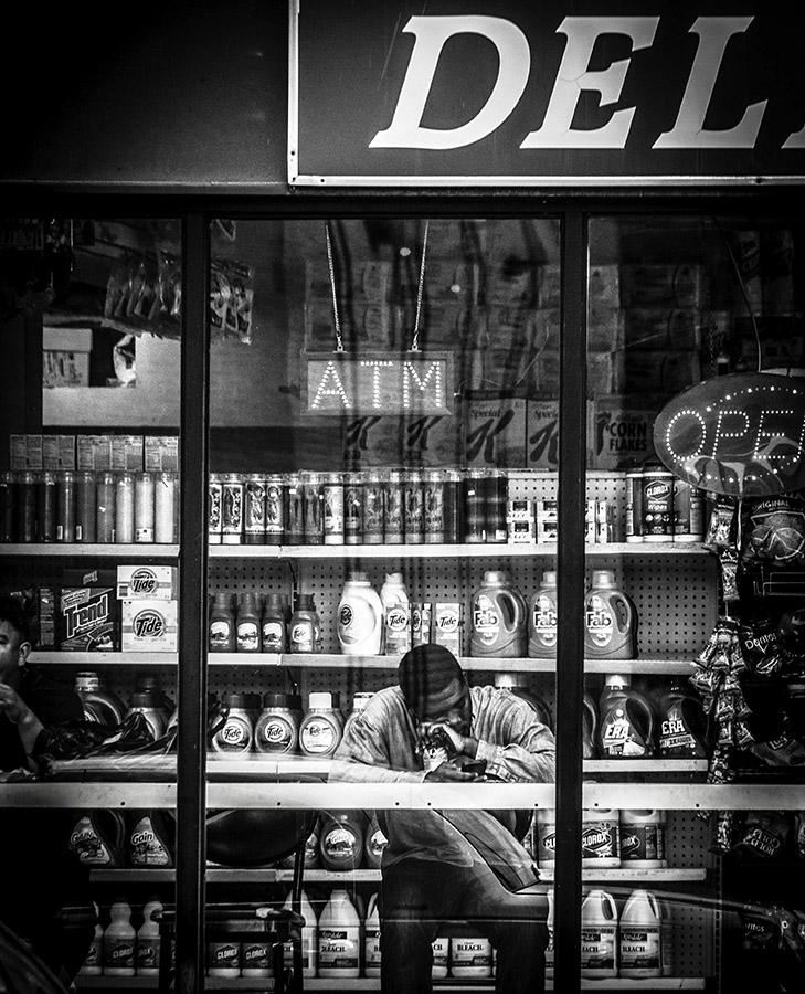 B&W Street Shot through Window - Sleeping Man