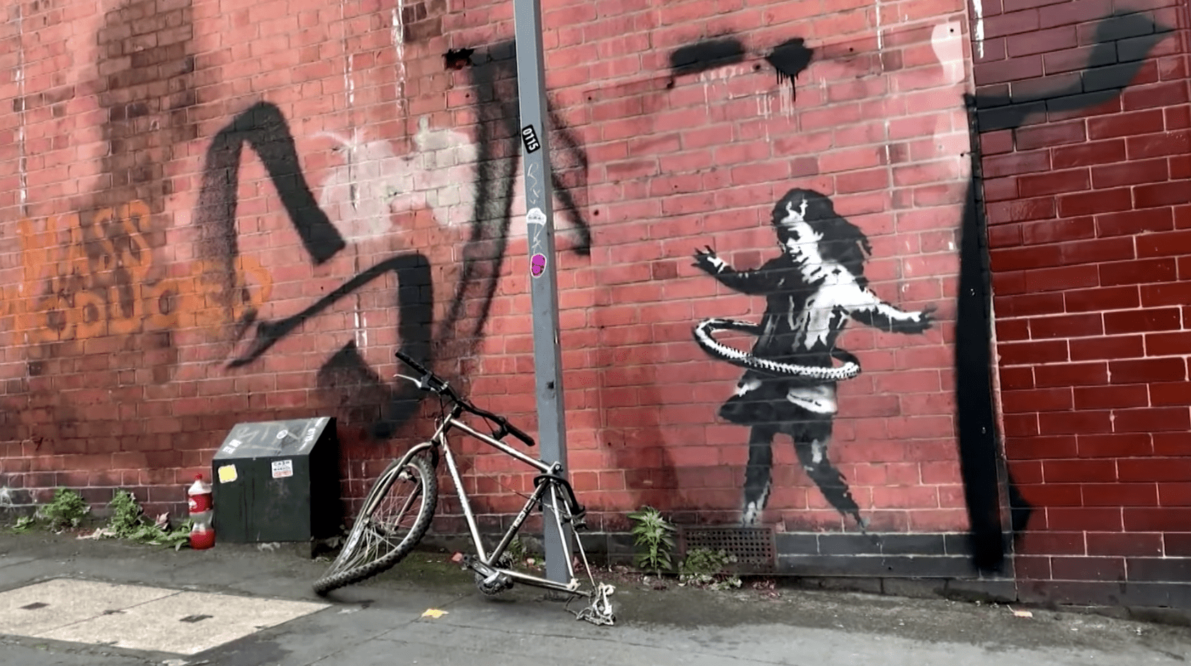 Banksy Departs From His Recent Political Art With Graffiti of a Hula-Hooping Girl