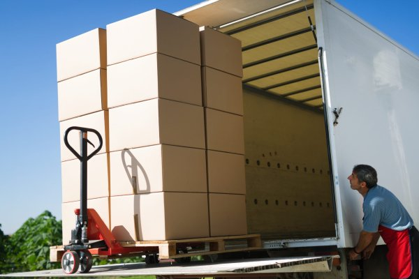 Cargo and goods transportation by truck carrying boxes