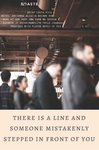 """Image description a line of people stand for coffee at the counter. Test says """"there is a line and someone mistakenly stepped in front of you"""" as a prompt"""
