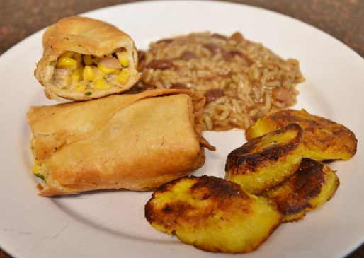 vegan corn chimichangas, fried plantains, and red beans and rice