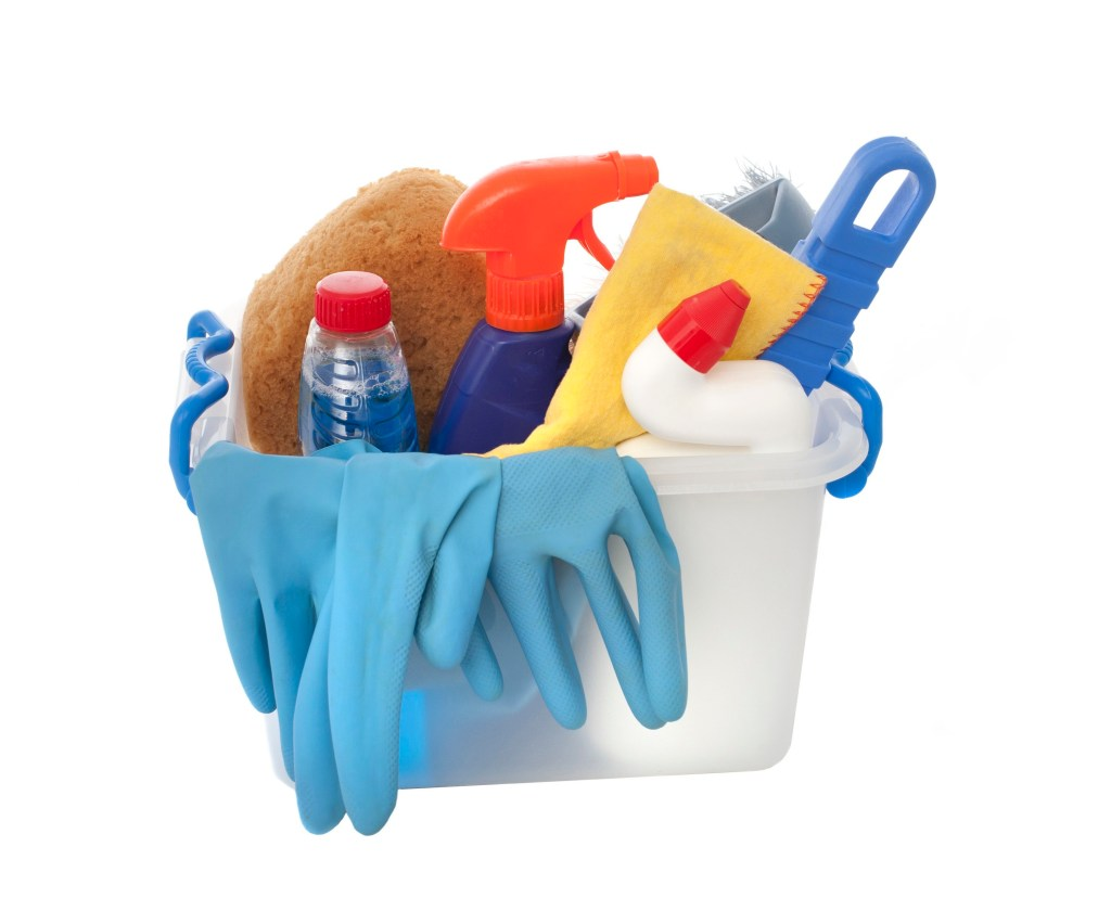 a plastic box containing domestic cleaning products, sprays, rubber gloves and cloths