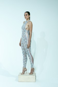 9. WHITE CONFETTI LACE UP CATSUIT