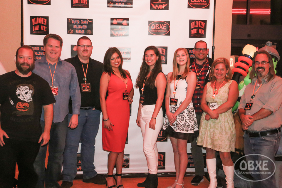 On the Orange Carpet, (from left) HIFF co-founder Matt Artz; 'Let's Go' writer/actor Tim Hass; 'Midnight Shift' director Dan Sellers; 'Close Calls' actress Jordan Phipps; 'The Transgressor' director Victoria Duncan; 'The Transgressor' actress Grace Folds; 'Lost in Buffalo City' director Raymond Wallace; HIFF co-founder Sue Artz; and 'The Cthulhu Candidate' director Alan Postscript, at the 2017 Halloween International Film Festival in Kill Devil Hills, NC on Oct 26, 2017. (photo: OBX Entertainment)