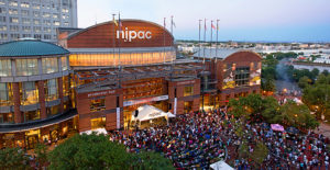 Photo of NJPAC with a packed crowd outside