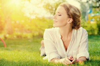 Healthy woman laying in the grass