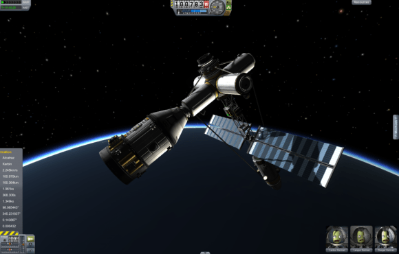 Crew quarters and 3 Kerbals docked with the space station. Note the illumination lighting up the station.