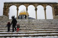 Palestinians walk in the snow in front of the Dome of the Rock on the compound known to Muslims as al-Haram al-Sharif and to Jews as Temple Mount, in Jerusalem's Old City January 10, 2013. The worst snowstorm in 20 years shut government offices, public transport and schools in Jerusalem and along the northern Israeli region bordering on Lebanon on Thursday. REUTERS/Ammar Awad