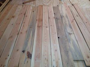 Planed pallet boards ready to use as flooring or siding