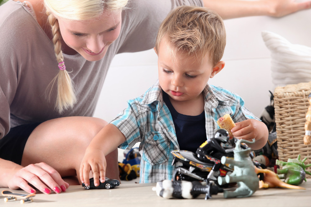 ocdc4u-mother-and-child-playing-with-toy-cars