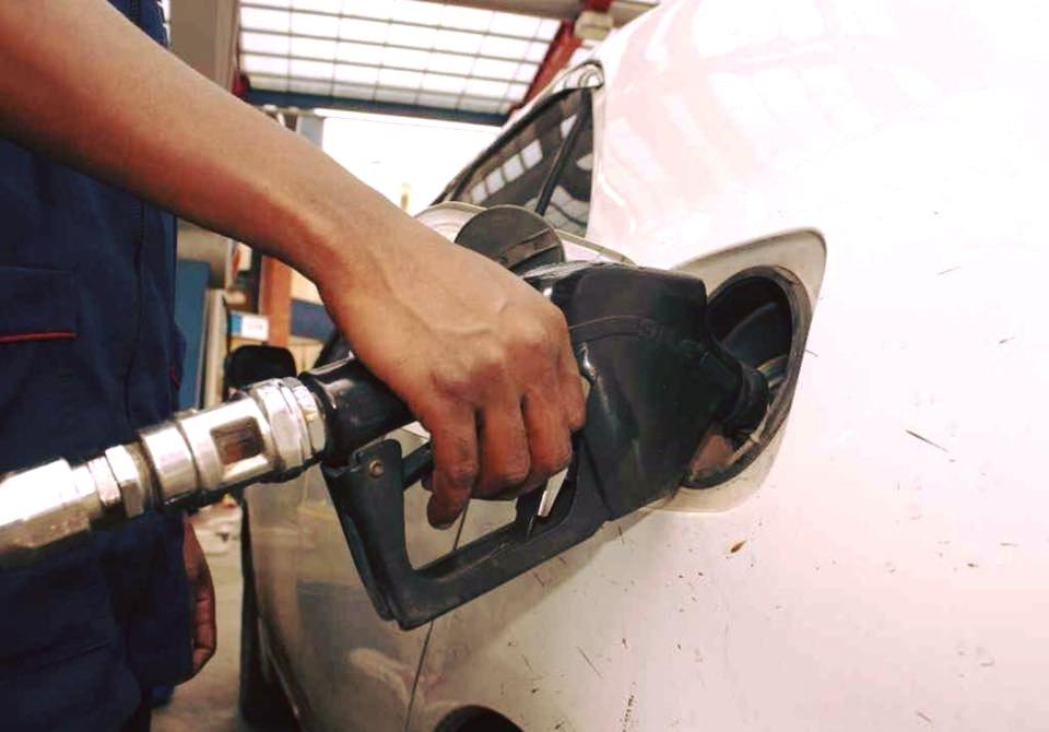 An attendant pumps fuel into a car