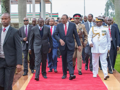 File image of a delegation receiving President Uhuru Kenyatta from a foreign trip