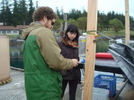 Phil and Natsuko taking water samples
