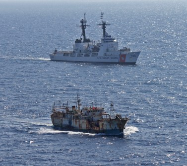 The crew of the Coast Guard Cutter Rush escorts the suspected high seas drift net fishing vessel Da Cheng in the North Pacific Ocean on August 14, 2012. (Credit: U.S. Coast Guard)