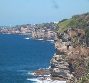 Sandstone cliffs tower over the ocean on the swim course from Bondi to Watson's Bay