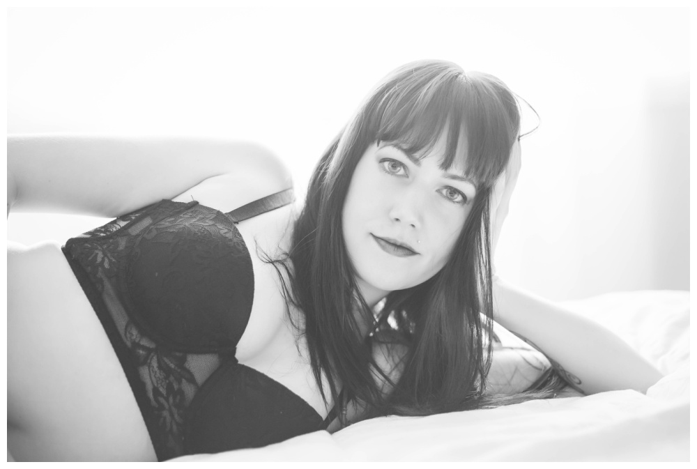 Black and white image of a woman laying on her side - nanaimo boudoir