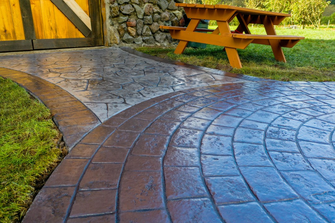 Colored patio and concrete stamped outdoor living space by Oregon contractor.
