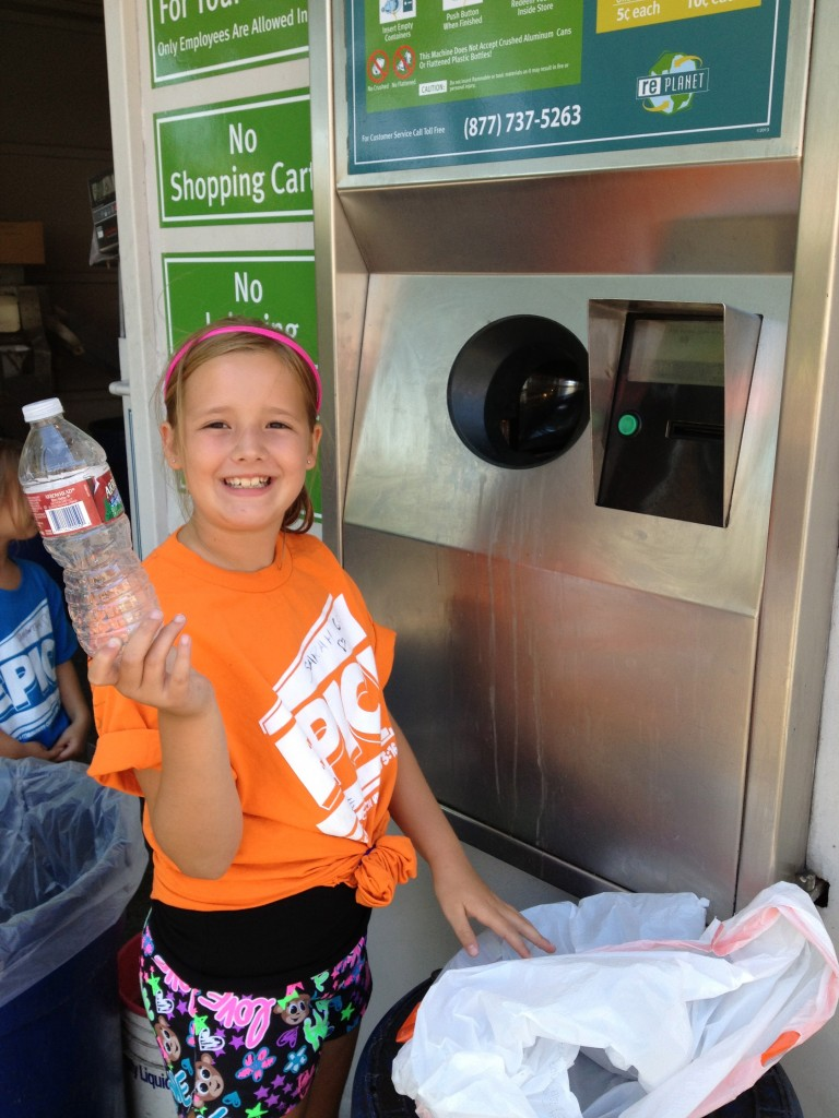 My older daughter, Sarah, happilly recycling.