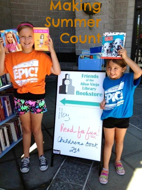 My girls donating books to our local Friends of the Library last summer.