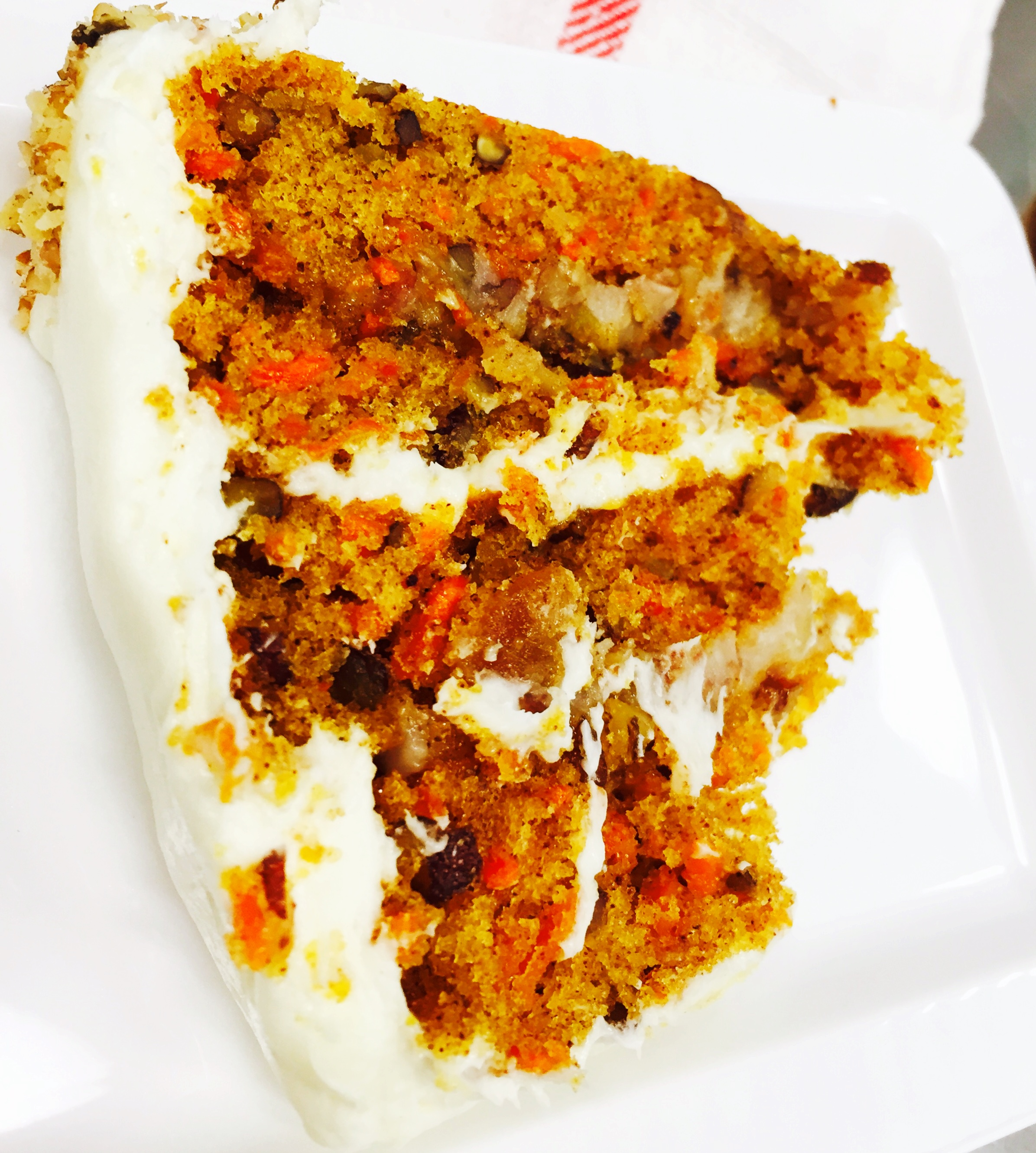 I'm not usually a carrot cake person, but this cake was amazing with its chunky praline filling, pecans and golden raisins topped with cream cheese frosting and bursts of cinnamon.