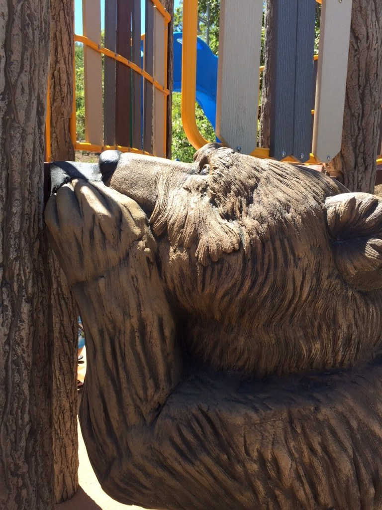 Bear on play structure